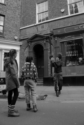 Children Watch a Street Performer